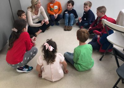 Kids in a mindfulness and manners class at a Being Aware Event