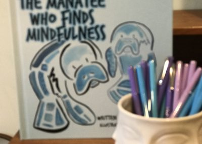 "A photo of the children's book, ""The Manatee Who Finds Mindfulness"""